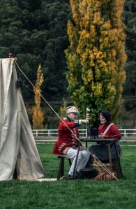 Members of the Macquarie's 73rd Regiment re-enactment group (l-r) Simon Fowler and Lea Barnett study an antique from the period. Photo: David Hill, Deep Hill Media